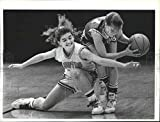 This is an original press photo. Heidi Faught (left) of Asotin tries to slip in for a steal but ends up causing Genny Mann of St. George's to stumble. Basketball high school B tournament 1990Photo measures 10.75 x 8.25 inches. Photo is dated 03-02-19...