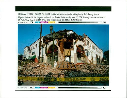 Vintage photo of The 1994 Northridge earthquake USA:bricks and debris sorround a building housing aras pastry.