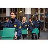 Leverage cast walking in FBI jackets carrying files away from building 8 x 10 Inch Photo