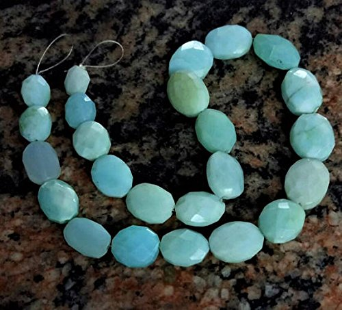 (Peruvian opal Faceted oval beads , with an amazing quality , 7.5 mm to 12 mm , 12 inch strand)
