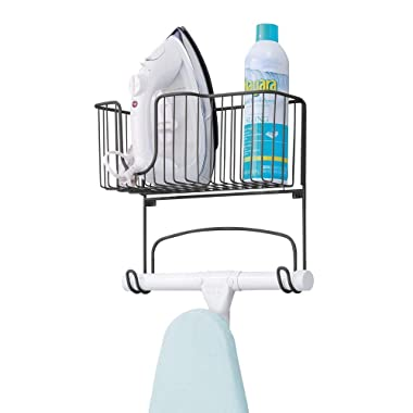 mDesign Metal Wall Mount Ironing Board Holder with Large Storage Basket - Holds Iron, Board, Spray Bottles, Starch, Fabric Refresher for Laundry Rooms - Matte Black