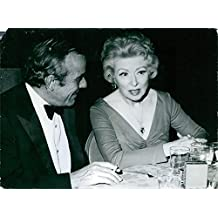 """Vintage photo of Grear Garson, so well remembered for""""Mrs Miniver"""" and other famous films, chats with a friend at a Hollywood party."""
