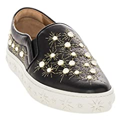 """Black Leather Slip ons with Pearl Embellishments and Gold Stitching around the Pearls. Spandex extension on tongue for easy slip on, molded stars around sole of shoe and padded on edges around the ankle. 1"""" lift in soles. Aquzzura branded log..."""