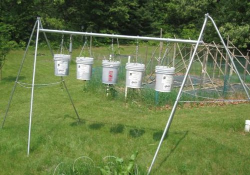 Do-It-Yourself Upside-Down Tomato Containers and Hanging Rack (DIY Done Right Book 1)