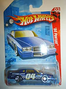 "Hot Wheels 2010 '' '84 PONTIAC STUNT CAR"" RACE WORLD - ""MOVIE STUNTS"" - 03 of 04 - 175/240 - Dark Blue - White Interior - Yellow Tinted Windshield - Graphics on side are ""04/STUNT CAR/ HD CAMERA/ HW / HOT WHEELS & CHECKERBOARD DESIGN"" REAR SPOILER"