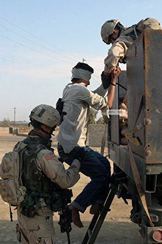 Photo U.S. Army Soldiers with the 1ST Battalion, 9th Infantry Regiment, 2nd Infantry Division, load a detainee onto a truck for transportation to Camp Ar Ramadi, Iraq, after a raid on houses suspected of harboring anti-coalition forces in Ar Ramadi, Iraq during Operation Al Fajr, in support of Operation IRAQI FREEDOM on Dec. 9, 2004.(U.S. Marine Corps official photo by Lance CPL. Andrew D. Young) (Released), 12/09/2004