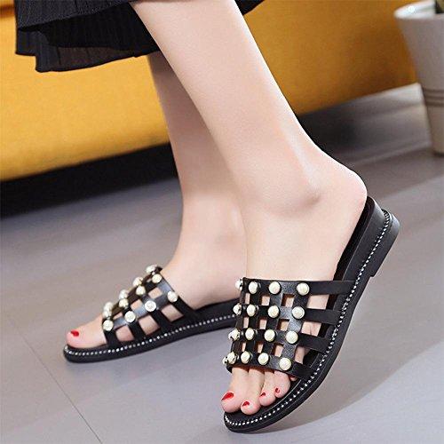 La primavera y el verano de moda salvaje remache arrastre plano la palabra fresco con antideslizantes de fondo grueso zapatillas las mujeres planas Black