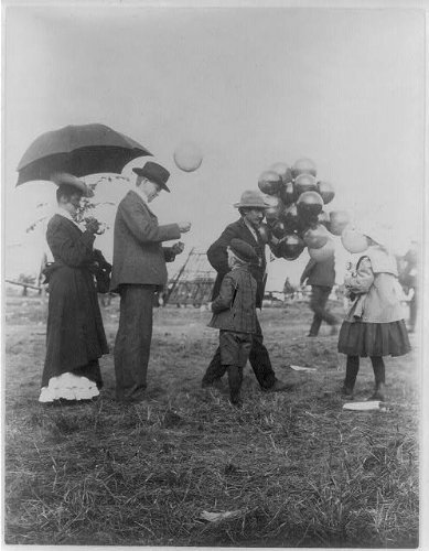 Photo: Minnesota State Fair,balloon vendors,crowds,tents,children,girls,boys,MN,1900