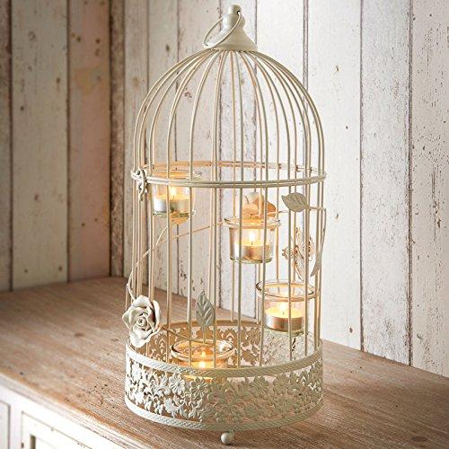 Farol (con 4 soportes para vela), diseño de jaula vintage: Amazon ...