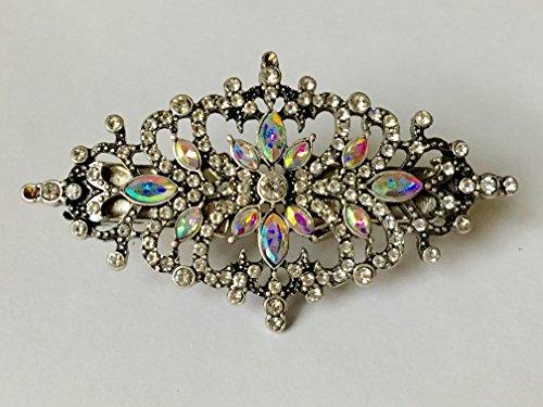 The mattie black metal and opalescent stone sweater clip brooch