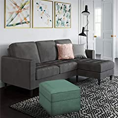 Glamify your sanctuary with the CosmoLiving Strummer Sectional Sofa. Covered in lush charcoal velvet upholstery, the sofa is perched on sleek contrasting black wooden legs for durability. Here are the deets: the Strummer's compact interchange...