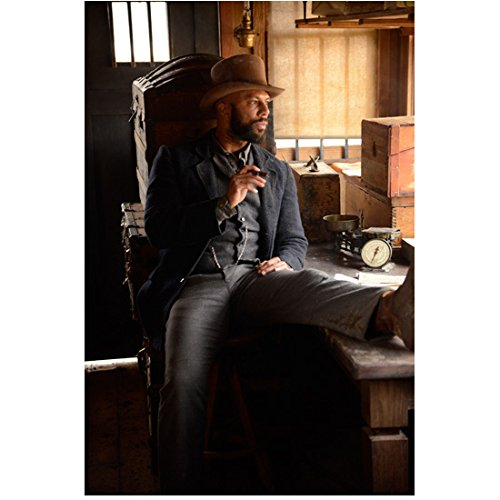 Hell on Wheels Common as Elam Ferguson Sitting on Counter Leg and Boot Up 8 x 10 inch photo - Marco Counter