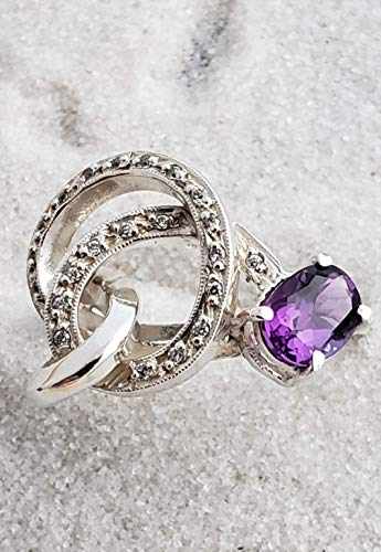 Swirl ring with amethyst and cz pave. ()