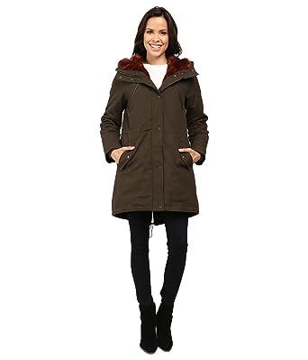 1e27c8f2e451 Vince Camuto Women's Faux Fur Trim Parka L1051 Olive/Rust X-Small at Amazon  Women's Coats Shop