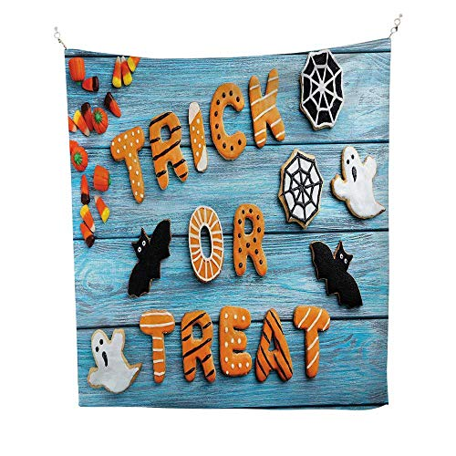 Vintage Halloweenocean tapestryTrick or Treat Cookie Wooden Table Ghost Bat Web Halloween 54W x 72L inch Large tapestryBlue Amber Multicolor