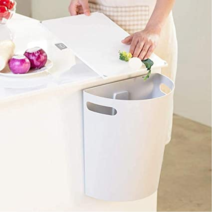 n a small trash can hanging waste bin