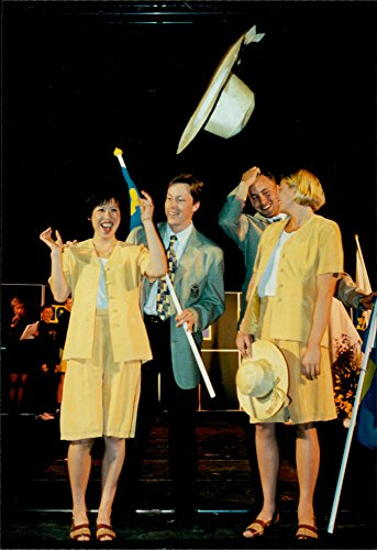 Vintage photo of Glue Xiao Ping, JO Waldner, Mattias Sunneborn and Linda Olofsson show off the Swedish Olympic Costumes for the Atlanta Olympic Games in 1996 (Costume Stores In Atlanta)