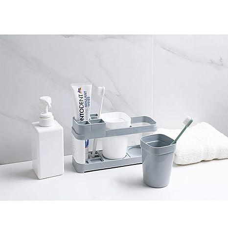 El tocador de la pasta de dientes y del cepillo de dientes de la encimera de