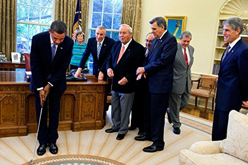 Gifts Delight Laminated 36x24 Poster: Barack Obama Takes a Practice putt in The Oval Office