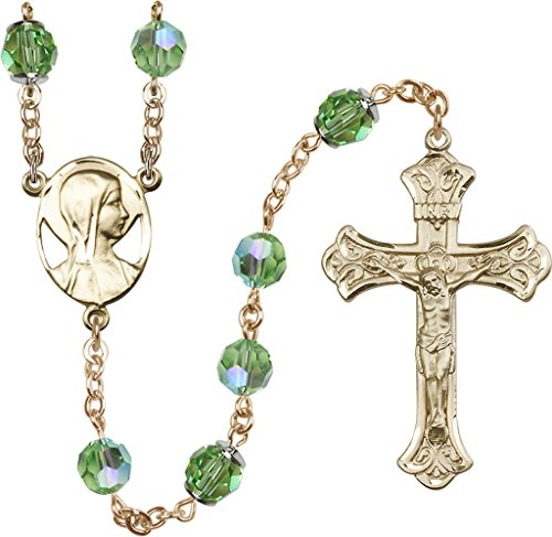 8mm Imitation Peridot Swarovski, Capped Our Father Aurora B-14kt Gold Filled Rosary features 8mm Imitation Peridot Swarovski, Capped Our Father Aurora Borealis beads. The Crucifix measures 1 7/8 x 1 1/8. The centerpiece features a Novena medal.-Each Rosary is presented in a deluxe velvet gift box. Hand-crafted in the USA by a group of talented artisans.