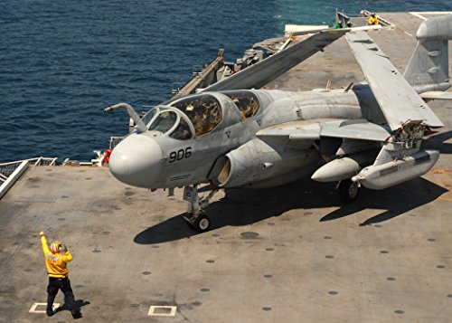 Home Comforts A plane director aboard the aircraft carrier USS George H.W. Bush (CVN 77) guides an EA-6B Prowler a - Uss Guide