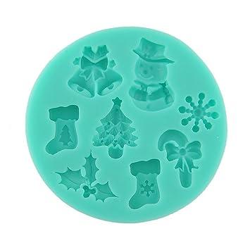 Molde de silicona para fondant con diseños navideños (árbol de Navidad, calcetín, muñeco de nieve, bastón de caramelo): Amazon.es: Hogar