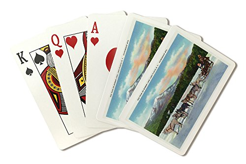 Sled Dog Team (Lake Placid, New York - View of a Dogsled Team on Mirror Lake during Winter (Playing Card Deck - 52 Card Poker Size with Jokers))