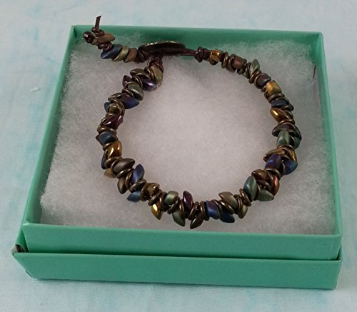 (Boho Artisan Metallic Jewel Tone Leafy Diamond Design Leather Woven Bracelet with Antique Brass Rings and Button Clasp. Versatile piece is great for everyday.)