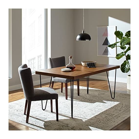 """Amazon Brand – Rivet Industrial Mid-Century Modern Hairpin Dining Table, 70.9""""L, Walnut and Black - This distinctive dining table appears to float on black metal legs shaped much like hairpins. A hardwood top with walnut finish is roomy enough for dining, but can also work as a desk in modern or industrial-style rooms. 70.9""""W x35.4""""D x29.5""""H Hardwood top with walnut finish; metal hairpin legs with black finish - kitchen-dining-room-furniture, kitchen-dining-room, kitchen-dining-room-tables - 51MLPeMXcFL. SS570  -"""
