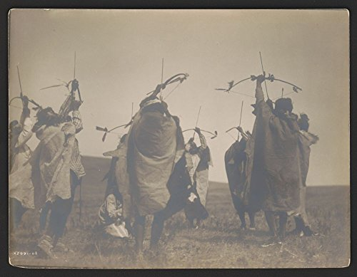 1908 Photo The flight of arrows an Atsina dance with Natives gathered in a circle around a central figure, posed as if shooting arrows toward the sky.
