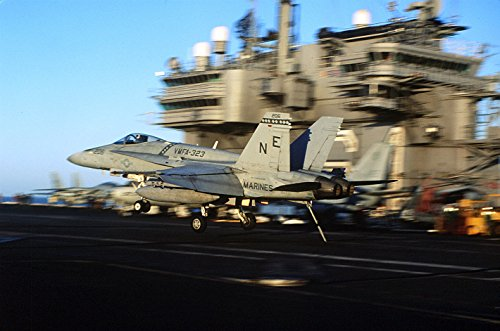 Home Comforts an F/A-18 Hornet assigned to Marine Fighter Attack Squadron 323 (VMFA-323) Lands Aboard The Aircraft