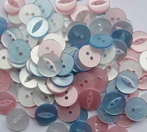 Collection of 10 pink fish eye buttons various shades and sizes.