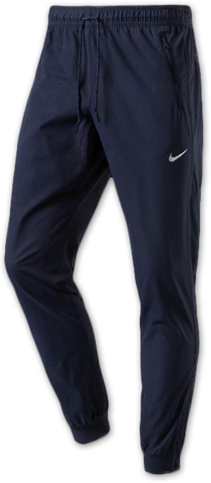 Nike Av15 Cnvrsn Wvn Pantalón Chandal, Hombre: Amazon.es ...