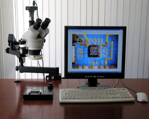 AmScope SM-6TZ-FRL Professional Trinocular Stereo Zoom Microscope, WH10x Eyepieces, 3.5X-90X Magnification, 0.7X-4.5X Zoom Objective, 8W Fluorescent Ring Light, Clamping Articulating Arm Stand, 110V-120V, Includes 0.5X and 2.0X Barlow Lenses
