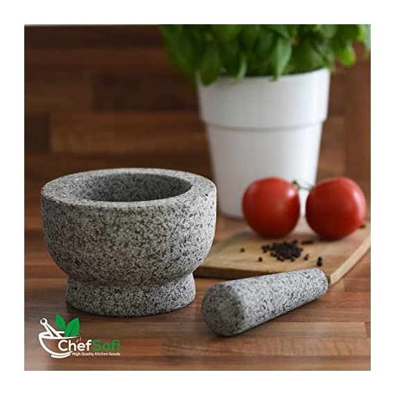 ChefSofi Mortar and Pestle Set - 6 Inch - 2 Cup Capacity - Unpolished Heavy Granite for Enhanced Performance and Organic Appearance - INCLUDED: Anti-Scratch Protector + Italian Recipes EBook 5 A kitchen must-have: Mortar and pestle set (mortero de cocina - morter and pessel - molcajete or guacamole bowl and pestel) has been used for THOUSANDS of years as THE way to crush, grind and powder herbs and dry spices. Contrary to an electric grinder or crusher, the age-old, durable, traditional manual grinding method ensures that all cooking ingredients bring out their full flavor and aroma profiles, allowing you to further control their texture and make delicious, chunk-free dishes. Versatile tool: Take advantage of your brand new stone motar and pedestal set's various applications in the kitchen and simplify your everyday life! Use your mortor to pulverize nuts, seeds, ginger root and garlic and make homemade salad dressing, sauces and condiments, such as fresh mustard, quacamole, pesto, salsa, chutneys and more. Widely used in pharmacies and apothecaries, your molcajete set will help you powder pills, for optimal ingestion, or hide them in your stubborn pet's kibble! Effortless use: This ChefSofi stone mocajetes motor & pedestal set was designed with your convenience in mind. Made from unpolished granite, you will waste no time fumbling or stabilizing your pestal masher, as our motar's cup interior provides the best, metate-like natural friction for swift ingredient crushing, grinding or powdering. With a 500 ml (approx. 2 Cup) capacity, this stone mortor also reduces the need for ingredient refills, affording quick food prep, in one go!