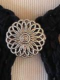 The mattie silver tone flower sweater clip brooch.