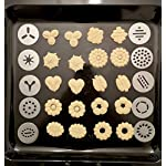 Earth's Dreams Cookie Press Gun Kit - Cleaning Brush Included: Dough Churro Maker, Spritz Biscuit Stainless Steel Decorating Set With 20 Shape Discs And 8 Icing Tips - Baking Supplies 17 BEAUTIFUL HOMEMADE COOKIES: You can now create stunning spritz cookies at home with this unique biscuit decorating kit in your favourite baking supplies! The cookie press gun comes with 20 different design discs, so you can mould beautiful sugar cookies. We also provide you with 8 metal icing tips for amazing creations and professional results. PREMIUM QUALITY MATERIALS: The cookie maker is made with the best quality materials for unique durability, amazing results and easy use. The biscuit presser is made with stainless steel and strong plastic, so you can rest assured that you're getting the best. All the materials used are odorless and non-toxic, so they can be perfectly safe for you and your family! COMFORTABLE AND EASY TO USE: The sugar cookie gun has an ergonomic design that will give you a strong and comfortable grip so you can use it with ease. The biscuit press gun has a unique trigger design so all you have to do is press it and get stunning homemade cookies! The cookie maker will give you fast results for maximum convenience.