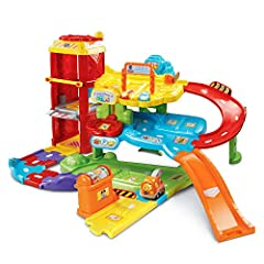 Playtime with miles of learning! Park, play and explore on three stories of interactive learning fun with Tommy and his tow truck at the Go! Go! Smart Wheels Park and Learn Deluxe Garage by VTech. Learn about colors, the rules of the road and...