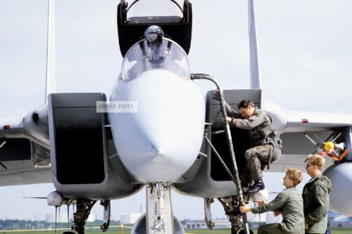 Photo A pilot from the 18th Tactical Fighter Wing boards an F-15 Eagle aircraft in preparation for takeoff. The F-15 is being scrambled after the report that Korean Airlines Flight 007 has been shot down by a Soviet aircraft, 09/25/1983