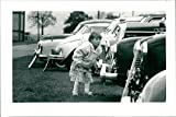 Vintage photo of Young car enthusiast checks the polish on vehicles at Transport 93 in Costessey Showground.