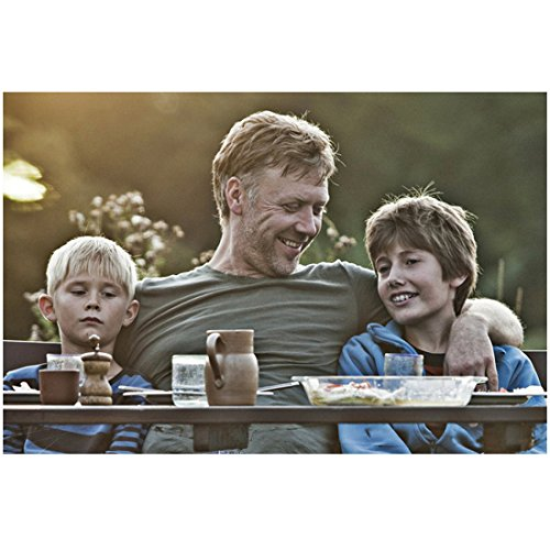 In a Haler World Toke Lars Bjarke as Morten, Mikael Persbrandt as Anton, and Markus Rygaard as Elias Sitting at Outdoor Table 8 x 10 inch photo