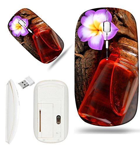 Luxlady Wireless Mouse White Base Travel 2.4G Wireless Mice with USB Receiver, 1000 DPI for notebook, pc, laptop, macdesign IMAGE ID: 24123893 Bottle with basics oil on tree bark and stones close up