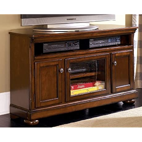Ashley W697 28 Porter Medium TV Stand Including 4 Shelves And 3 Doors With Adjustable Shelf Bun Feet And Hole S For Wiring In Rustic