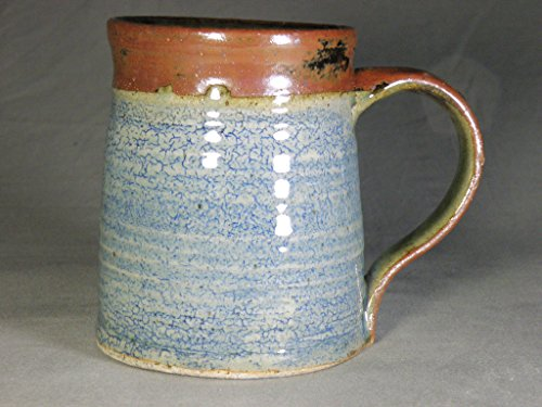 - Large 18 oz handmade wheel thrown coffee cup with blue crackle finish.