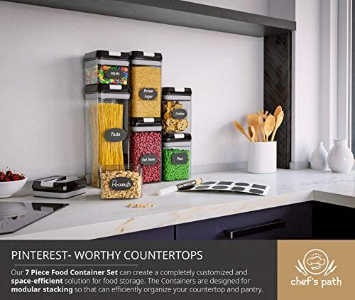 51MaiqD2ftL. AC Chef's Path Airtight Food Storage Container Set - 7 PC Set - Labels - Kitchen & Pantry Organization Containers - BPA-Free - Clear Plastic Canisters for Flour, Cereal with Improved Lids    YOUR SEARCH FOR THE PERFECT FOOD STORAGE CONTAINER SET IS FINALLY OVER✮ BUILD TO LAST - We have taken meticulous care to ensure that the containers you receive will last for years to come. Unlike most sellers on Amazon which have lids that easily break with use, our containers come with New and Improved Lids which are made up of High Impact Resistant and Durable ABS Plastic which means you don't need to worry about the Lids breaking. Additionally the Lid-Lock Mechanism ensures maximum freshness and prolonged food storage.by creating 100% airtightness.✮ BEST BANG FOR YOUR BUCK - We provide a higher TOTAL STORING CAPACITY unlike most others on Amazon. Includes 1 Large Container (8.0 cups /1.9 liters), 2 Medium Containers (5.1 cups /1.2 liters), 2 Small Containers (3.4 cups /0.8 liter), 2 Mini Containers (2.1 cups /0.5 liters). These air tight containers come in a wide variety of shapes and sizes for all your storage needs.✮ SUPERIOR BUNDLE - Your Complete Bundle comes with 7 BPA-FREE Premium Food-Storage Canisters, Reusable Chalkboard Labels allowing You to organize your pantry like never before. This set comes in a beautiful box which makes it an IDEAL GIFT for any family. Nobody else in the market provides more Value to you than usVERSATILE CONTAINERS - MANY GREAT USES: These air-tight food-safe Keepers are not only IDEAL for storing dry foods such as flour, sugar, rice, grain, cereals, nuts, beans, snacks, pasta, spaghetti, noodles, coffee and tea and but they are also PERFECT for holding liquids such as water, juice, soup, and more. No need to worry about liquids spilling out, just push down the handle and let the airtight technology do it's magic✮ SPACE SAVING DESIGN - These Durable Square Containers have been especially designed to MINIMIZE SPACE, they are STACK