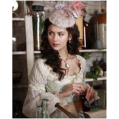 The Vampire Diaries (TV Series 2009 - ) 8 inch x 10 inch photograph Nina Dobrev in Old-Fashioned Costume in Store Holding Bottle kn]()