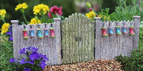 miniature-fairy-garden-planter-gate-boots-are-attached-to-fence