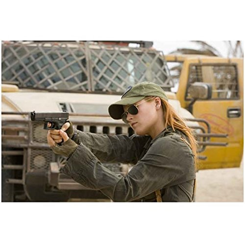 Resident Evil: Extinction (2007) 8 inch by 10 inch PHOTOGRAPH Ali Larter from Waist Up w/Gun Wearing Sunglasses & Cap Truck in Background ()