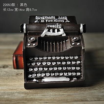 El viejo modelo de máquinas de escribir adornos Home cafés Internet para manejar la resina antigua