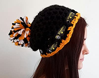 crochet Steelers girl inspired hat. with pom pom. Made by Bead Gs on AMAZON. Black and gold. Ladies size.